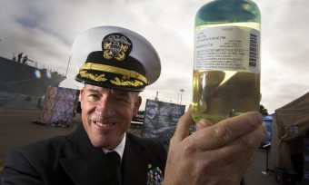 Capt Brian Weiss holds a sample of biofuel blend
